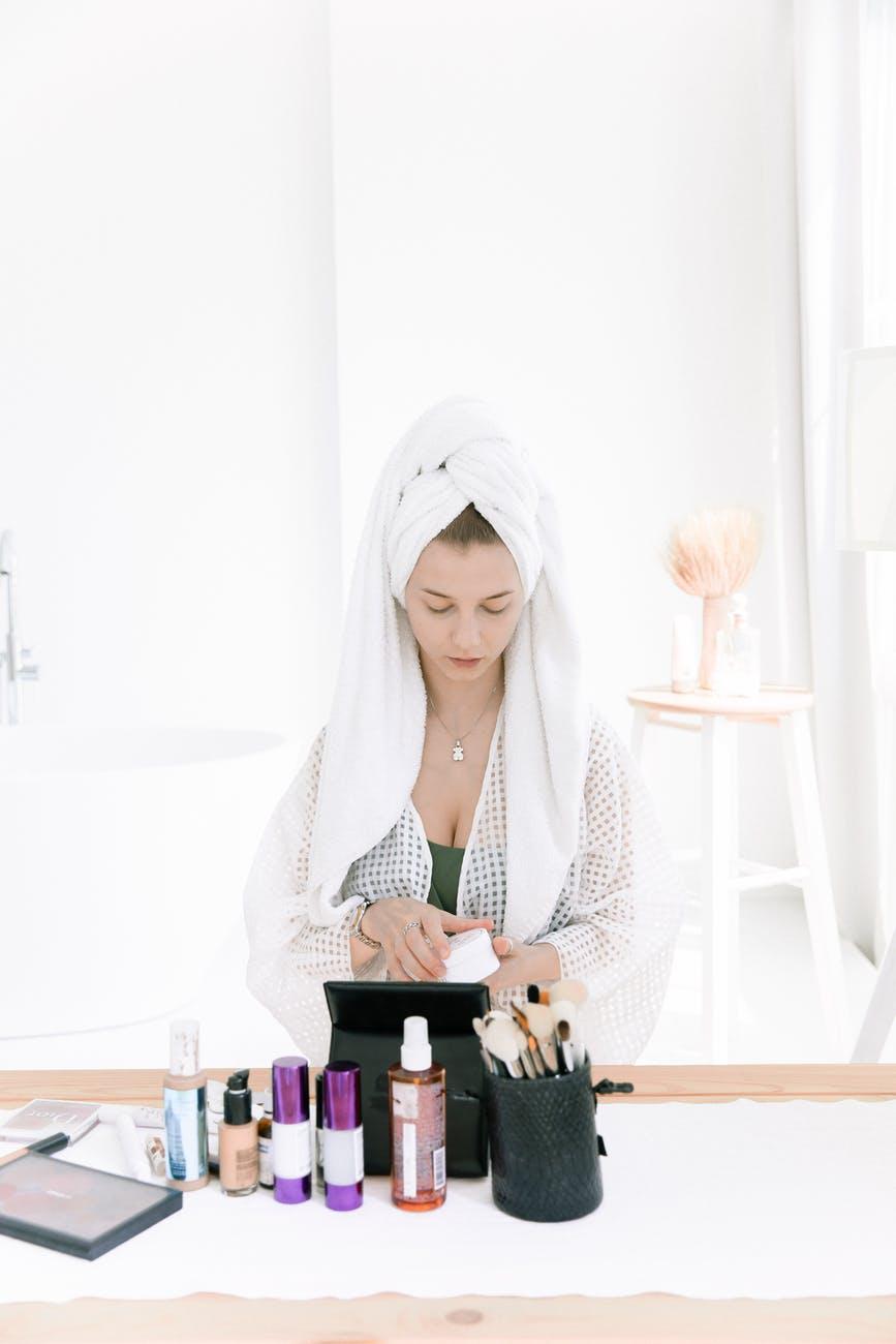 photo of woman wearing bathrobe
